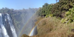 Panorama: Sandra in a Rainbow at Victoria Falls