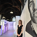 Painter Amy Rogers pictured with her work of road cyclist Alex Dowsett