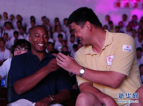 August 24th, 2012 - Yao Ming watches a performance at a primary school with LA Clipper Caron Butler