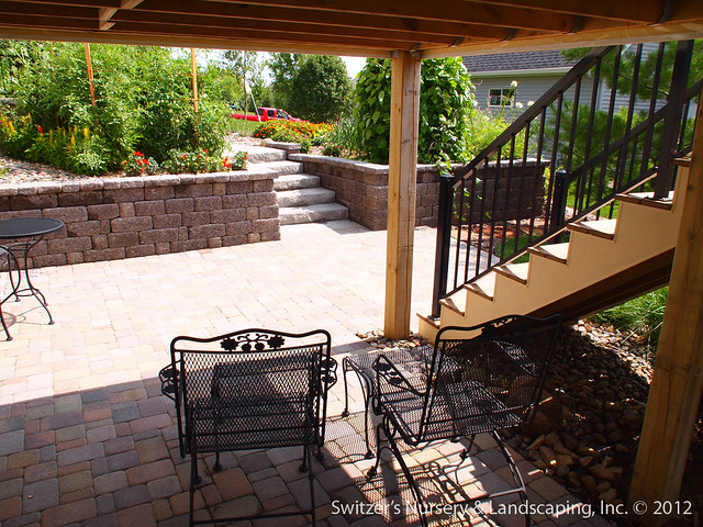 paver patio under deck with retaining wall  u0026 steps