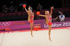 floor gymnastics(0.0), uneven bars(0.0), sports(1.0), performing arts(1.0), gymnastics(1.0), gymnast(1.0), entertainment(1.0), artistic gymnastics(1.0), rhythmic gymnastics(1.0),