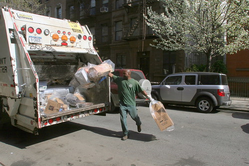 Sanitation Worker collecting recyclables | by New York City Department of Sanitation