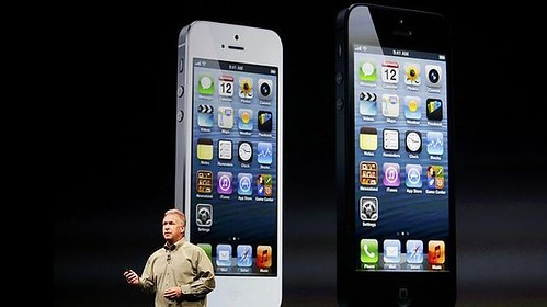 Apple CEO Tim Cook and iPhone 5