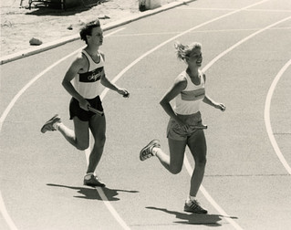 Two runners take part in the dedication of the new Strehle Track during Alumni Weekend 1986