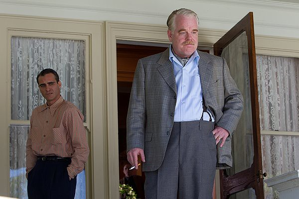 Joaquin Phoenix and Philip Seymour Hoffman try to make sense of 'The Cause' in THE MASTER.