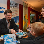Ian Rankin book signing | Ian Rankin signs his book for a reader