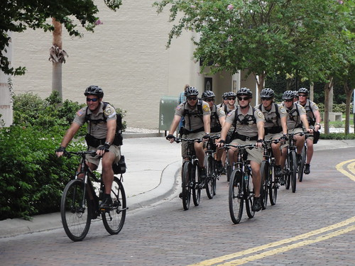 Police officers on bikes traveling in packs