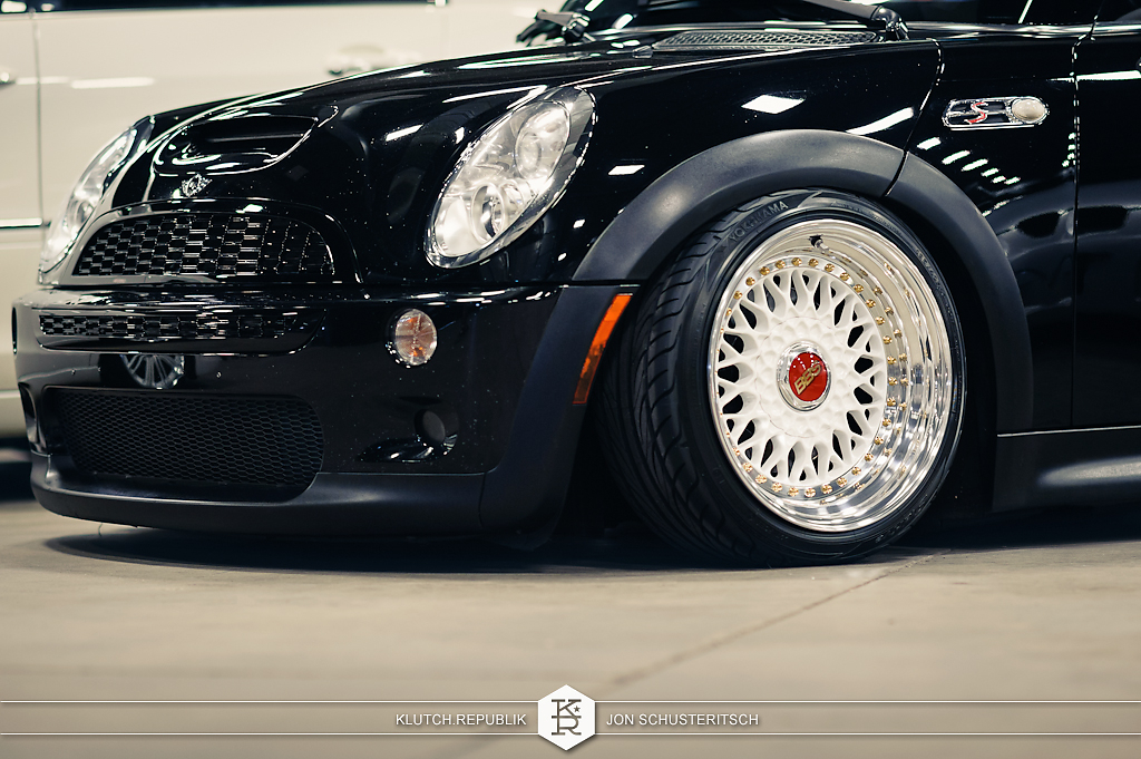 black mini cooper on bbs rs at wekfest east 2012 new jersey convention center 3pc wheels static airride low slammed coilovers stance stanced hellaflush poke tuck negative postive camber fitment fitted tire stretch laid out hard parked seen on klutch republik