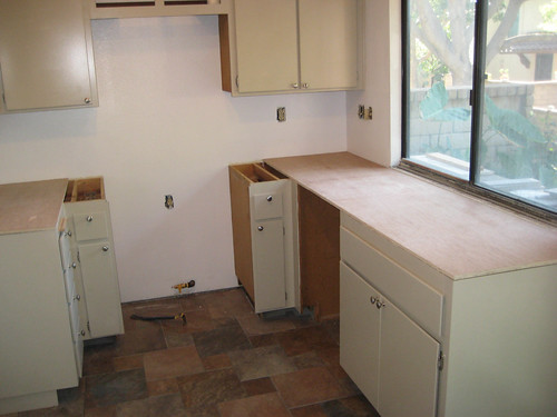 Kitchen waiting for countertops and sink