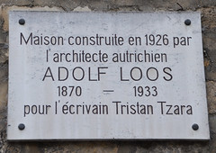 Photo of Adolf Loos and Tristan Tzara white plaque