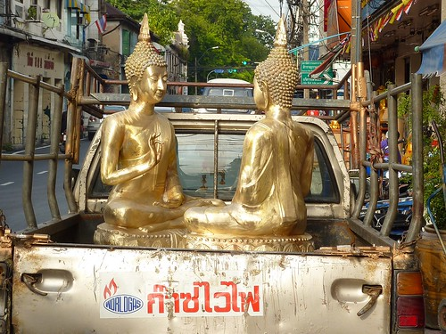 Delivering Buddha statues