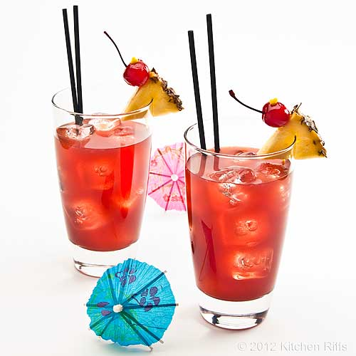 Singapore Sling Cocktails with Pineapple and Maraschino Chery Garnish, White Background