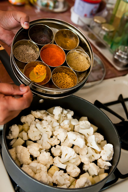 Adding spices from the masala dabba