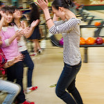 12-002 -- New international students enjoy a bowling party.