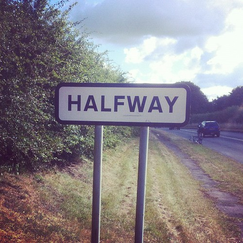 half way Halfway definition: 1 in the middle of something, or at a place that is equally far from two other places: 2 not very, but enough to be satisfactory:  learn more.