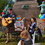 Fergus McNicol and Mio Shapley | Fergus McNicol and Mio Shapley entertain the children with stories and songs and their kamishibai theatre bicycle