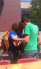 Students praying after an outreach
