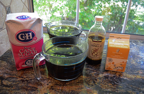 All the ingredients required to make Coffee Granita with Vanilla Cream arranged on a counter top.