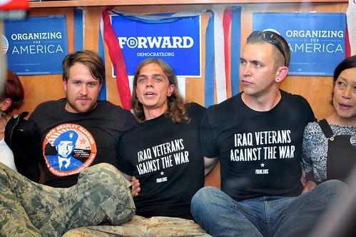 "IVAW members wearing ""free manning"" shirts"
