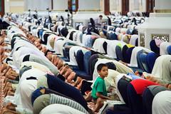 A boy among worshipper in Muhammad Ibn Abdul Wahab Mosque