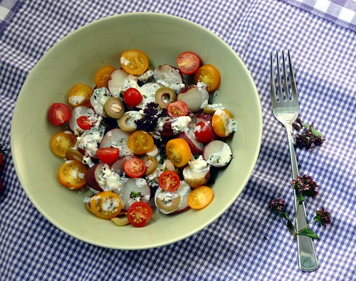 Potatoes with Feta Drizzle and Oregano Flowers