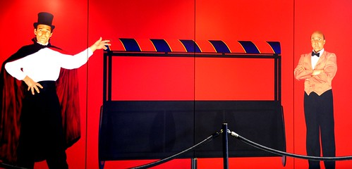 Emptiness: The Magic Trick, magician & assistant, top hat and cape, painted panels, magic box, red, black, blue, white, painting, Seatac Airport, Seattle, Washington, USA