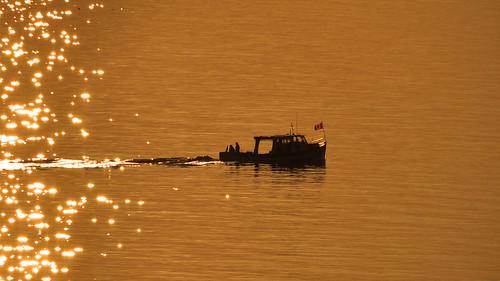 ocean light sunset boat novascotia capebreton