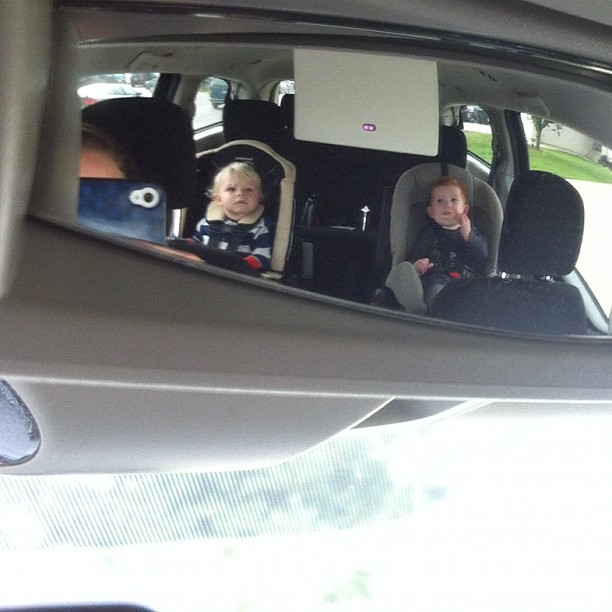 My little buddies in my rear-view kid mirror. Watching Backyardigans while we wait for the girls. (Note: the vehicle is in park.)