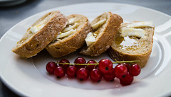 Bread, butter, honey and cranberries