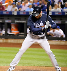 Braves first baseman Freddie Freeman takes a pitch in the first inning.