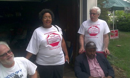 Jennifer Britt standing with supporters Pat Driscoll and Kevin Carey sitting, along with David Sole standing. Britt is fighting Fannie Mae to halt an illegal eviction. (Photo: Abayomi Azikiwe) by Pan-African News Wire File Photos