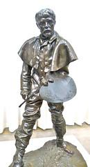 army men(0.0), bust(0.0), infantry(0.0), monument(0.0), art(1.0), sculpture(1.0), metal(1.0), bronze sculpture(1.0), figurine(1.0), bronze(1.0), statue(1.0),