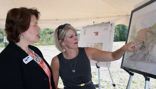 U.S. Department of Agriculture (USDA) Rural Development (RD) Business and Cooperative Programs Administrator Judith Canales (left) and President of the Board of Directors Kim Barker discuss the plans for the new $1.6 million in Community Facility loan funding for the Riverhouse Children's Center in Durango, CO on Thursday, Aug. 30, 2012. USDA photo by Amy Mund.