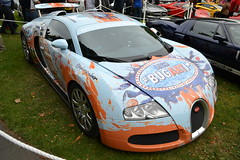 race car(1.0), automobile(1.0), bugatti(1.0), wheel(1.0), vehicle(1.0), performance car(1.0), automotive design(1.0), auto show(1.0), bugatti veyron(1.0), land vehicle(1.0), supercar(1.0), sports car(1.0),