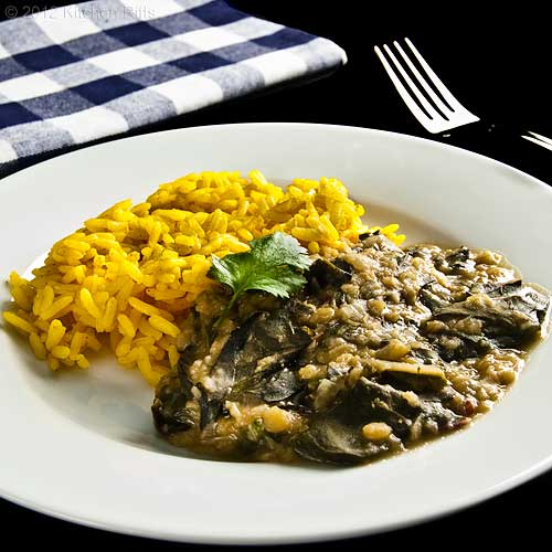 Dal with Swiss Chard on Plate with Yellow Rice, with Napkin and Fork
