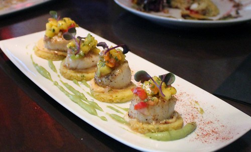 Scallops atop Polenta Cakes with Avocado Mouse and Mango Salsa