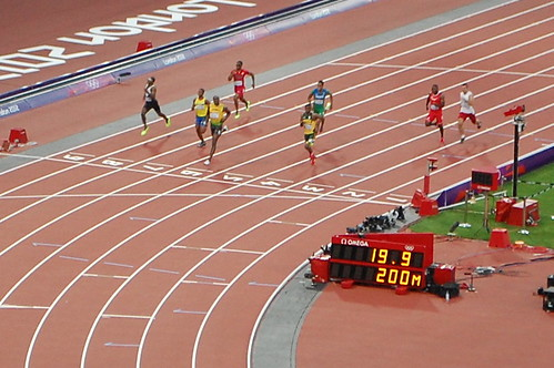 Usain Bolt about to cross the line