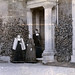 Three women in a doorway. 1890s.
