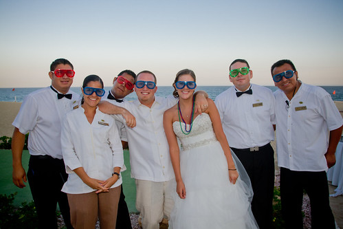 bride and groom fun picture with staff all wearing shutter shades