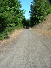 Kevin rides towards the landslide on the CZ haul road
