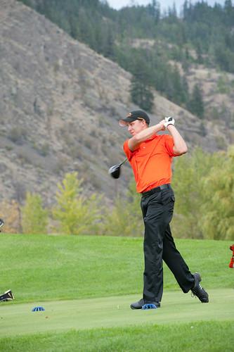 Blake Gozda teeing off (vertical Robert Clark photo)