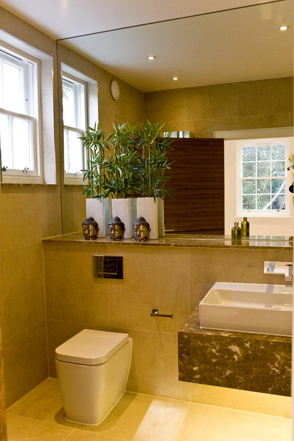 Baños Modernos Rectangulares:diseño de baño en diferentes volúmenes y con acabados diferente, el