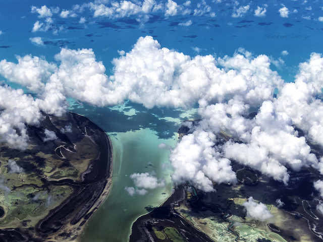 Clouds Over Turquoise Waters