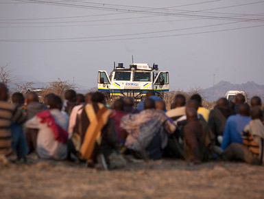 South African miners standoff with police at the Lonmin in Rustenburg. A massacre by police has resulted in over 30 reported deaths. by Pan-African News Wire File Photos