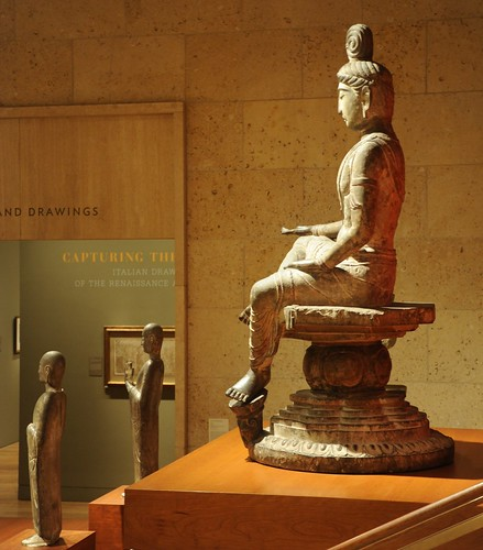Bodhisattva with open hand, palm up, top knot, seated in posture of royal ease, left foot on a lotus, wearing a mala, flowing garments, mandala seat, statue, 8th Century, Tang Dynasty, Limestone, Art Institute of Chicago, Illinois, USA by Wonderlane