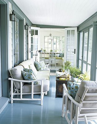 screened porch sunroom_blue white painted floor_outdoor rooms_house beautiful
