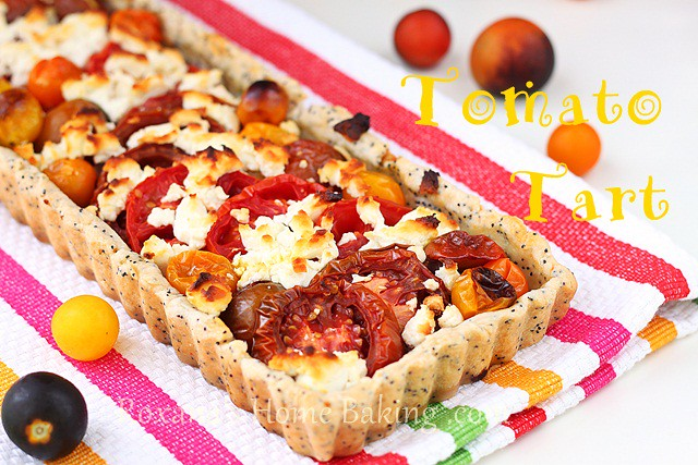 Tomato tart with poppy seed crust and goat cheese - buttery poppy seed and thyme crust, colorful cherry and kumata tomatoes and crumbled goat cheese. Recipe from Roxanashomebaking.com