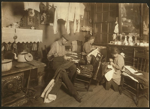 11:30 A.M. Jennie Rizzandi, 9 year old girl, helping mother and father finish garments in a dilapidated tenement, 5 Extra Pl., N.Y.C. They all work until 9 P.M. when busy, and make about $2 to $2.50 a week... (LOC) by The Library of Congress