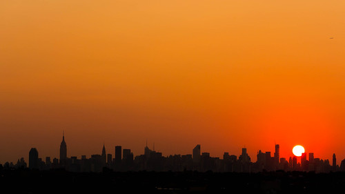 Sun Setting over the Manhattan Skyline, as seen from Flushing, Queens.