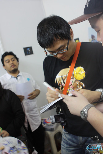 Danny-san is signing the photobook